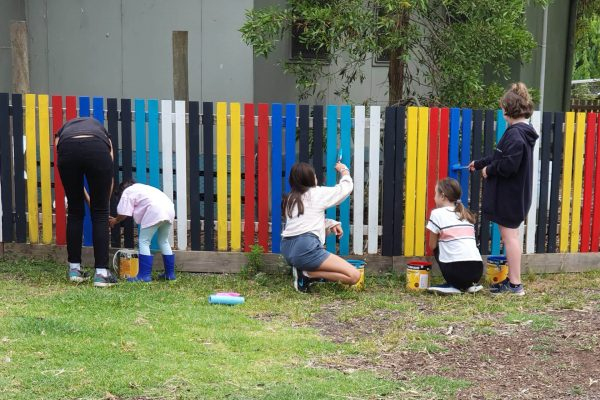 Village School Farm Day - Painting the Colourful Food Garden Fence