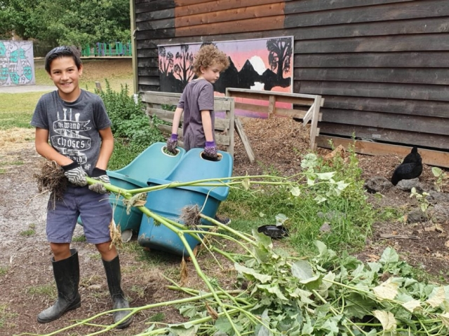 Village School Farm Day - Student Helpers Cleaning Up