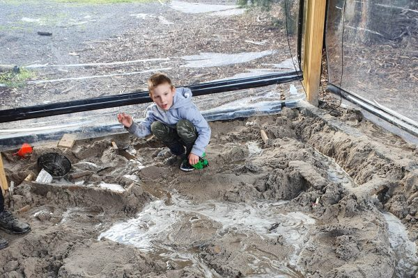 Creating a water landscape in the sandpit