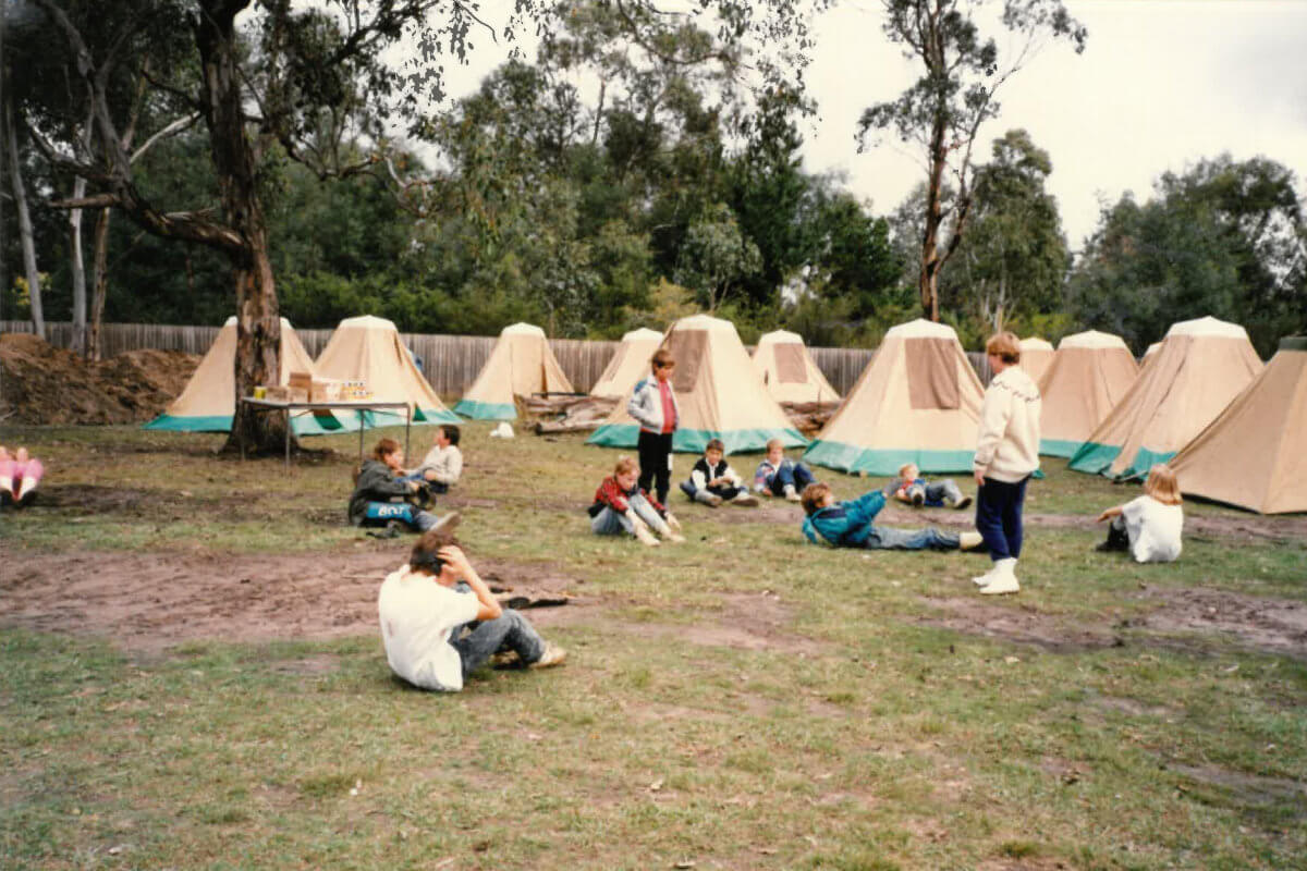 Our History - School camping outdoors in tents