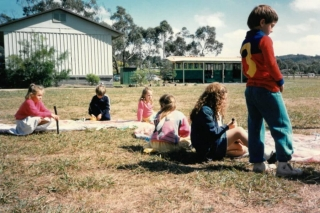 Our History - Sitting outside on the grass