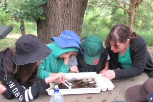 Our Holistic Philosophy - Teacher with Students Outdoors