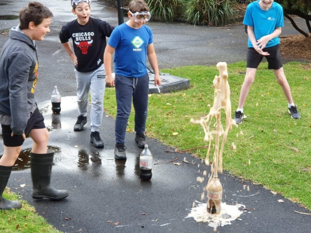 Steam science experiment with mentos and coke