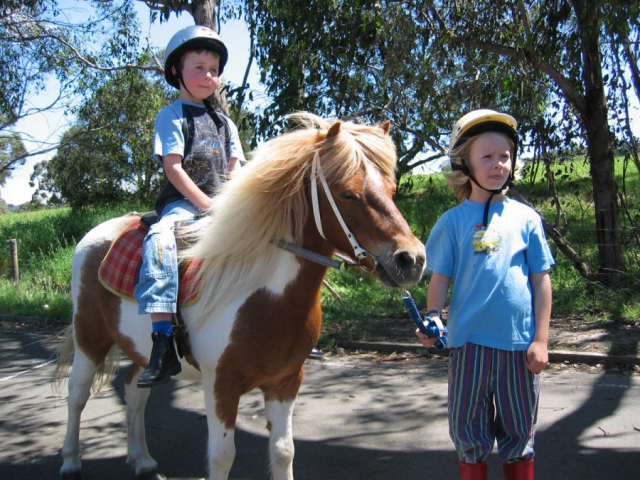 Student Leading Another Student on a Pony