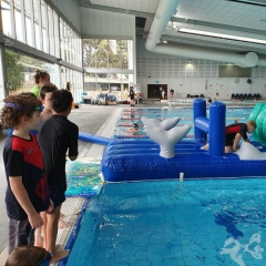 Swimming lessons on the inflatables at Croydon Leisure Centre